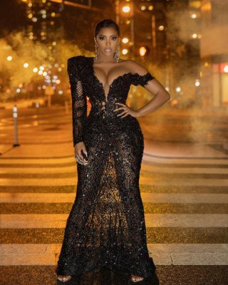 Real Housewives of Atlanta star Porsha Williams was an embodiment of gone with the wind fabulous in a stunning custom Ese Azenabor black beaded sheer floor-length gown for the recently filmed dungeon themed season 13 reunion. For makeup, Porsha opted for a neutral makeup look featuring a short pixie cut. She took her ensemble to the next level with a jaw-dropping custom crystal claw ring set and crystal chandelier earrings. According to her stylist, Porsha wore Eze Azenabor for the season 10 reunion as well. Credits Model: @porsha4real Dress: @eseazenabor Jewellery: @houseofemmanuele Shoes: @gianvitorossi Hair: @deestyling Makeup: @kendrickkenbeauty Stylist: @therealnoigjeremy Photography: @sterlingpics