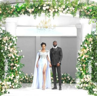 "@acupofkhafi wed in a gorgeous white slit dress, styled by Swanky Jerry that showcased her toned legs while her husband looked handsome in a classic black tux. @gedoni , also took to his page to share the news with his fans. He shared a photo from their December 2019 engagement and accompanied it with a caption: ""A year ago she said ""YES"" and some months later she said ""YES"" again, this time to FOREVER. It's not been an easy year especially for you. You lost your(our) brother and Covid19 happened. Amidst all these heaviness and heartbreaks you still love and LOVE DEEPLY. I don't take you for granted IYAWO MI."" #weddinggown #wedding #weddingdress #nairobifashionhub #nairobifashion #naija"